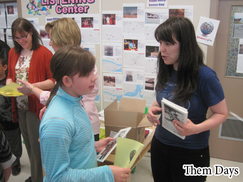 Handing out a magazine to another young History Pinner. I like this picture because it looks like we're making the same face!